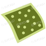 A green napkin or pillow with polka dots