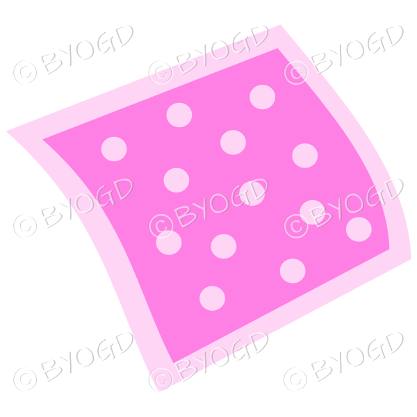 A pink napkin or pillow with polka dots