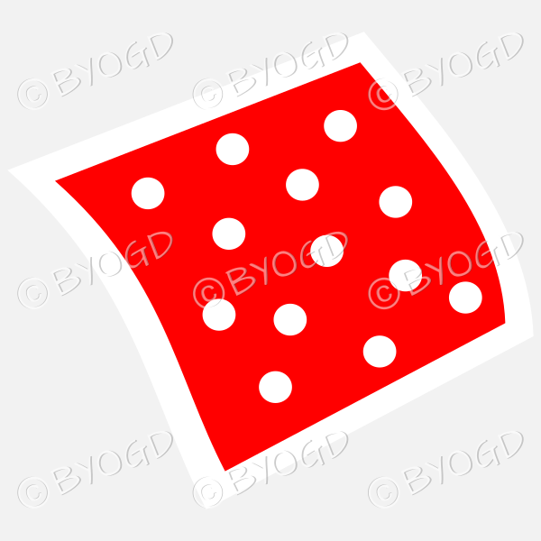 A red napkin or pillow with white polka dots