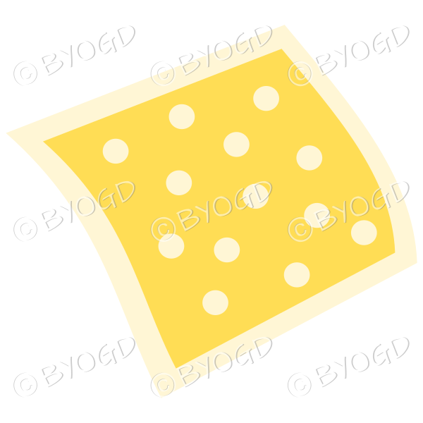 A yellow napkin or pillow with polka dots