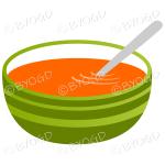 Orange carrot soup in a green bowl