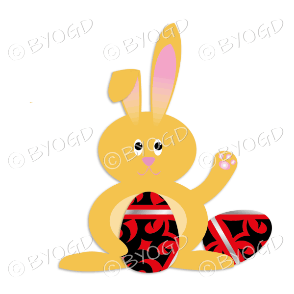 Orange Easter bunny waving with black, red and silver decorated Easter eggs