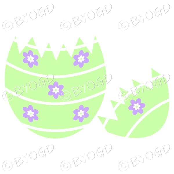 Cracked green Easter Egg with purple and white flower decoration