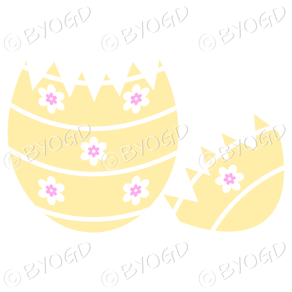 Cracked yellow Easter Egg with white and pink flower decoration